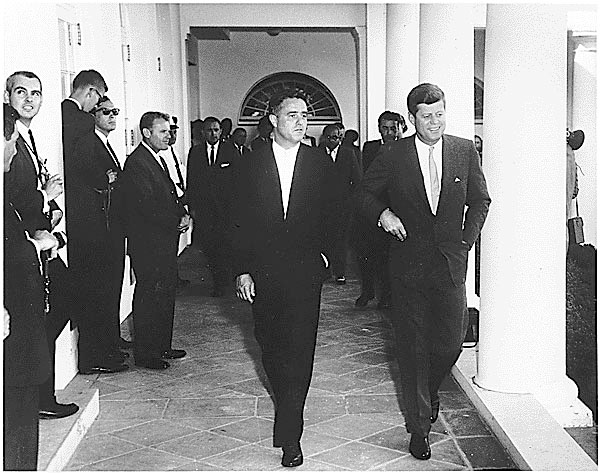 Sargent Shriver and President Kennedy greet Peace Corps Volunteers to Ghana and Tanganyika in the West Wing Collonade at the White House, August 28, 1961.