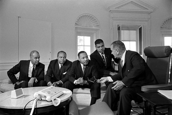 Martin Luther King, Jr. (3rd from left), with Roy Wilkins, James Foarmer, adn Whitney Young, met with President Lyndon Johnson in the Oval Office in January 1964. (LBJ Library)