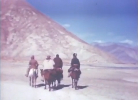 "OSS spies Brooke Dolan and Ilia Tolstoy traveling to Lhasa (still from ""Inside Tibet"", Records of the Office of Strategic Services)"