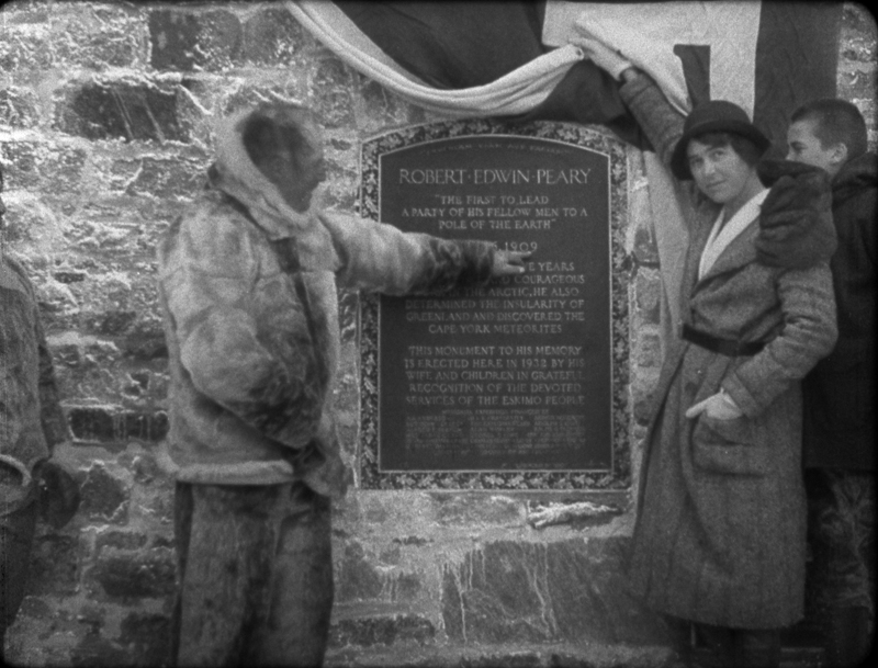 Marie Peary Stafford poses with the plaque at the base of the monument.