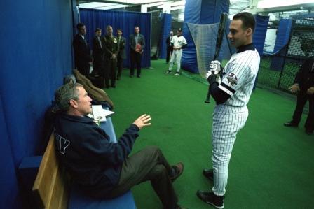 President George W. Bush talks with Yankee shortstop Derek Jeter