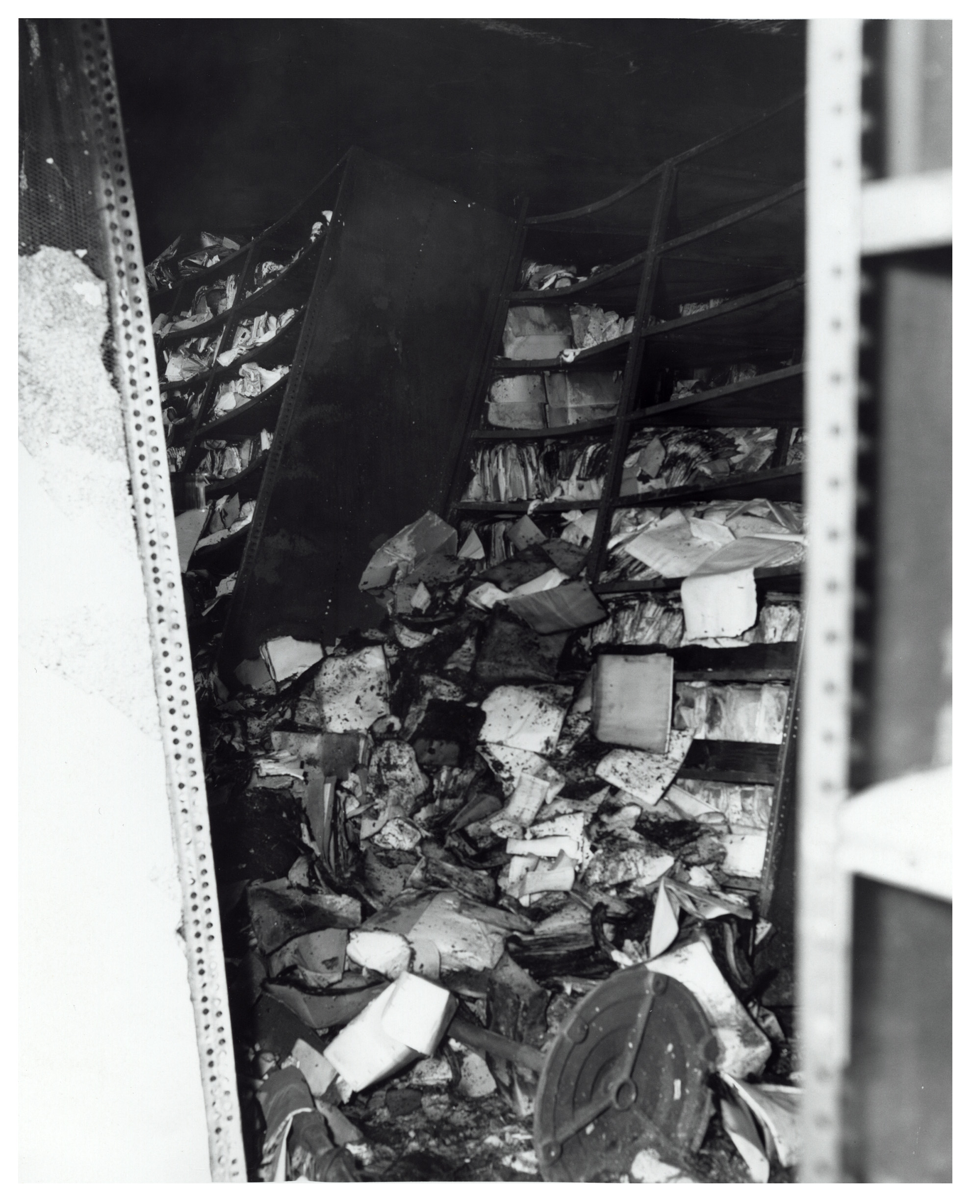 As the fronts of boxes burned away, records spilled to the floor, providing further fuel for the fire.