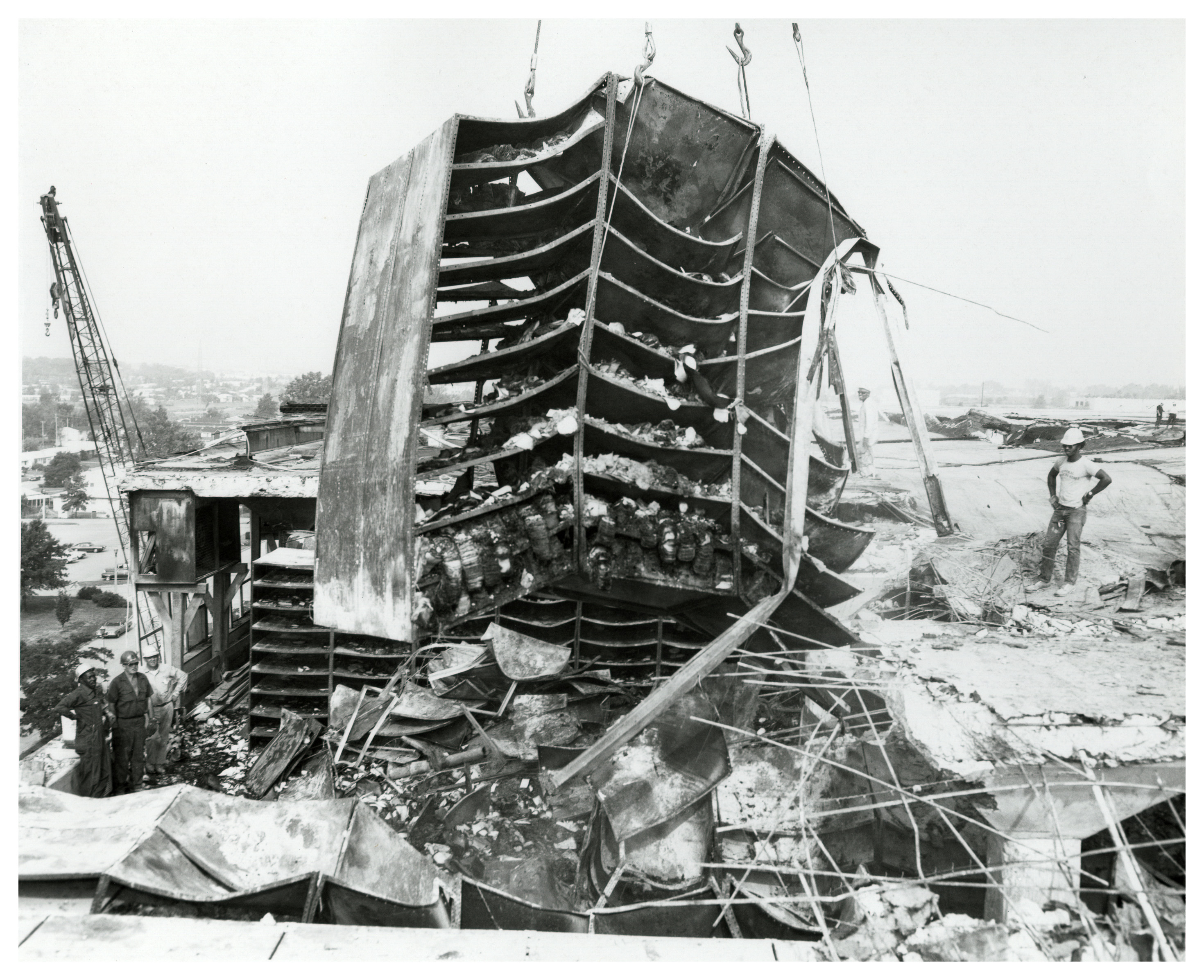 Not until demolition and removal of the collapsed roof and the damaged shelving occurred would staff realize how many records, even near the fire's origin, had actually survived the fire. Pooling water allowed boxes on the lowest shelves to absorb water, while records that fell in to the aisles also received protection from the standing water. (National Archives, Record Group 64)