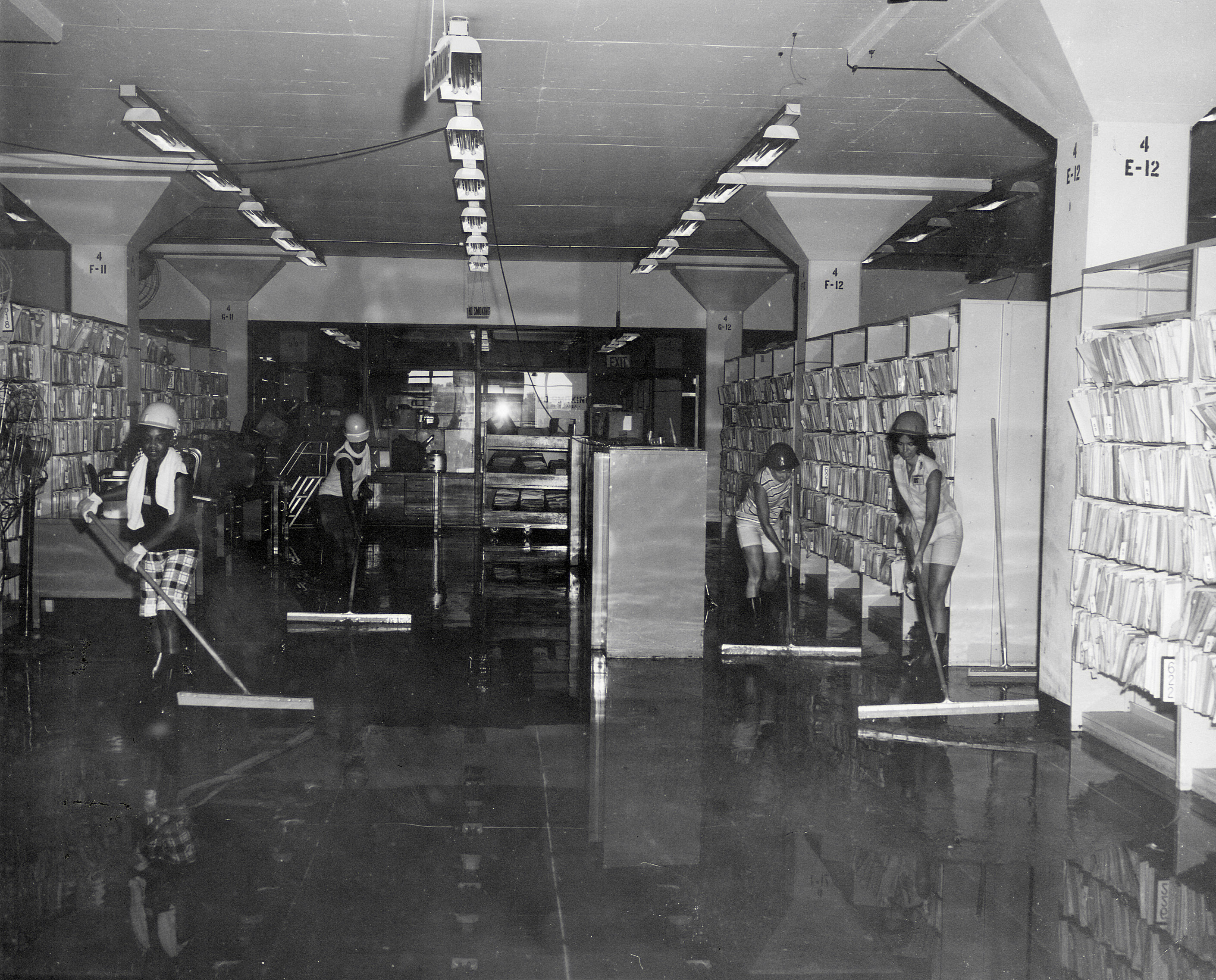 While on site, Waters witnessed the accidental damage of additional, previously dry records, when workers squeegeeing water on lower floors created waves that, in one single ten minute period, sent water into 9,000 bottom drawers of cabinets. (National Archives Record Group 64)