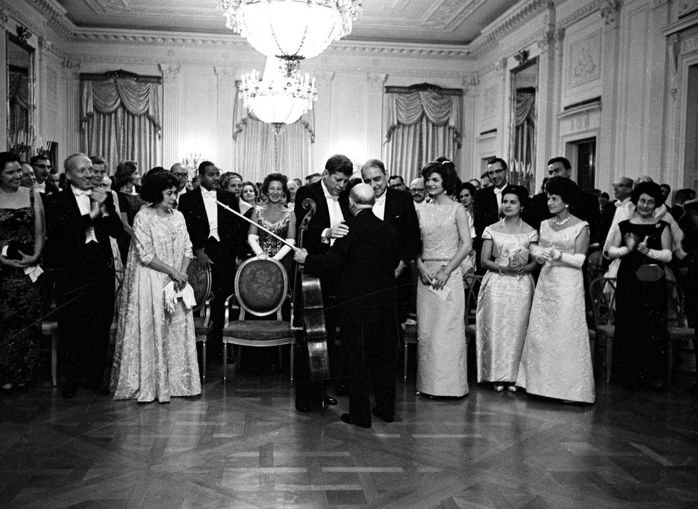 President John F. Kennedy and Governor of Puerto Rico Luis Muñoz Marín speak with cellist Pablo Casals after his performance at a state dinner. (Kennedy Library, ST-273-3-61)
