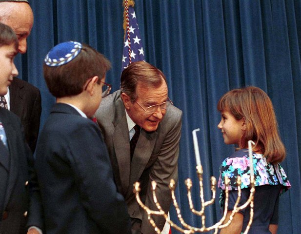 George Bush participates in a Hanukkah Celebration in the Old Executive Office Building. 12/21/1989.