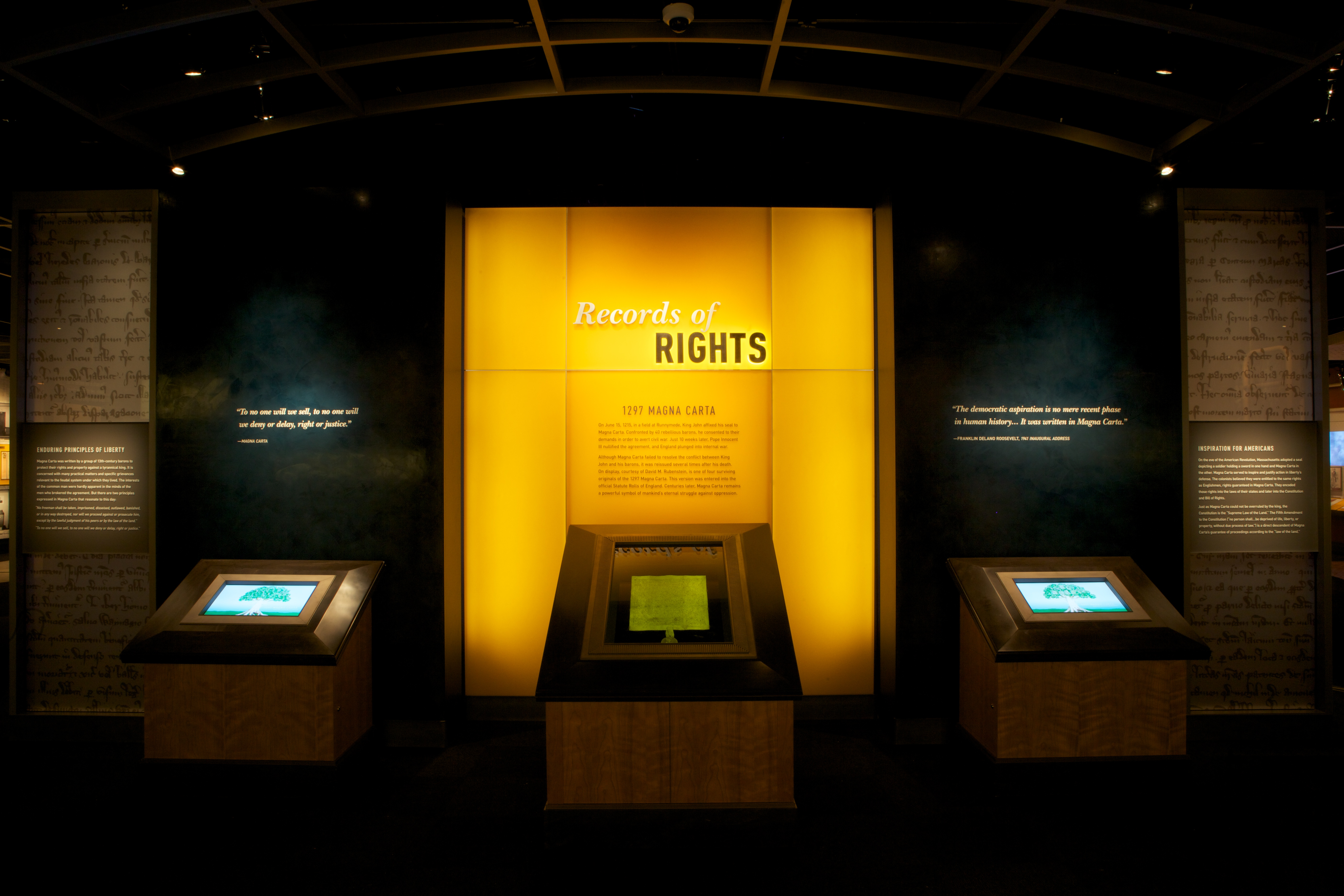 """The 1297 Magna Carta, on loan from David M. Rubenstein, at the entrance of the new """"Records of Rights"""" exhibit."""
