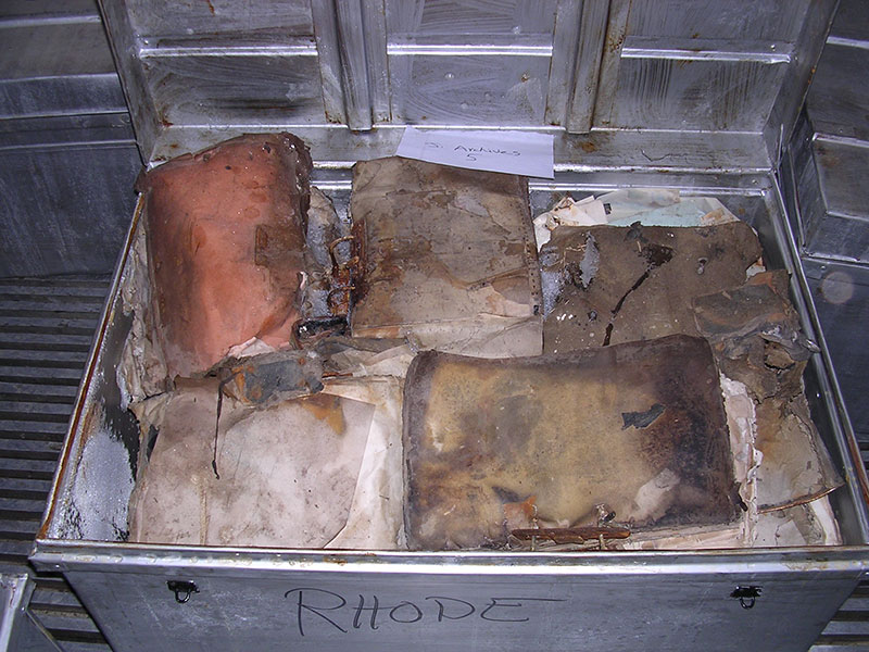 Water-damaged books and documents inside a freezer truck in Baghdad.