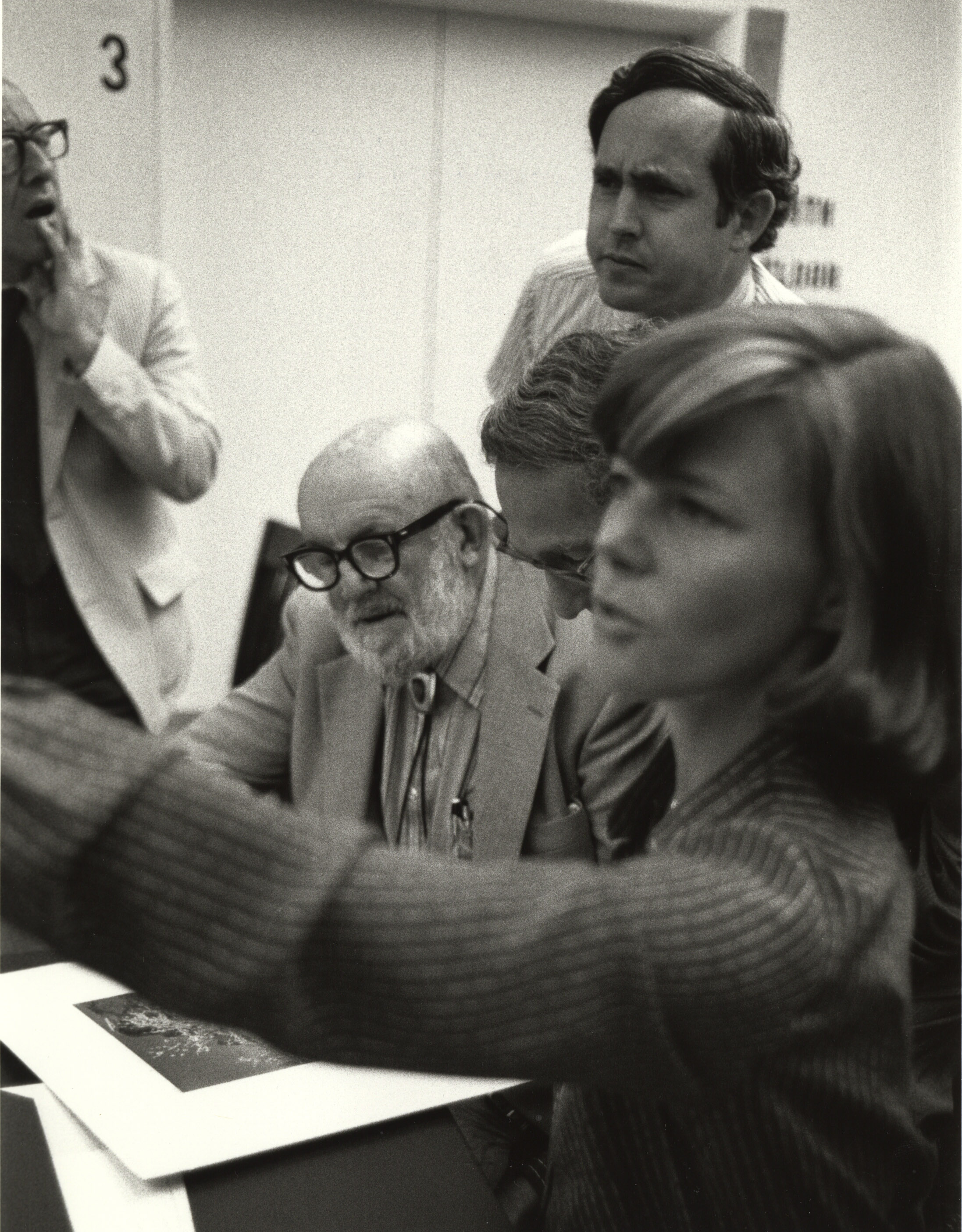 """Original caption reads: """"Visit to the National Archives by the famous American photographer, Ansel Adams, to look at some of his work in the Still Picture Branch, September 10, 1979? (64-MISC-1-5)"""