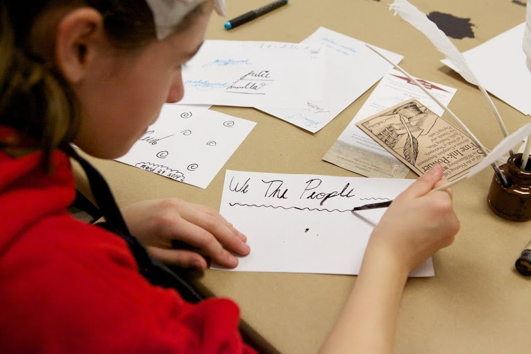 This young visitor learned to write with a quill pen, just like the Founding Fathers.
