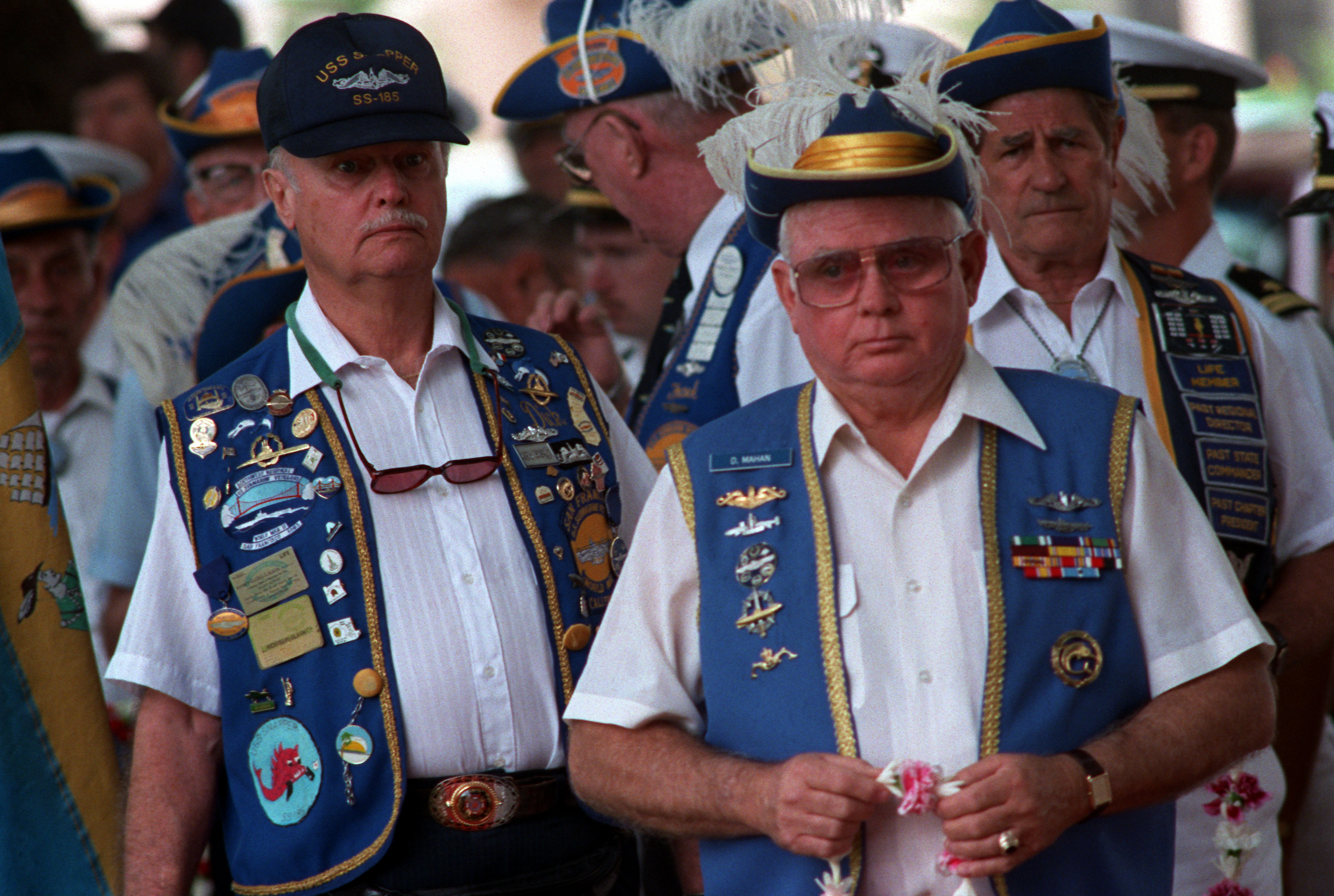 World War II submarine veterans take part in a ceremony honoring their counterparts who lost their lives during the war. The ceremony is taking place as part of an observance of the 50th anniversary of the Japanese attack on Pearl Harbor. 12/06/1991. NAI 6476472.