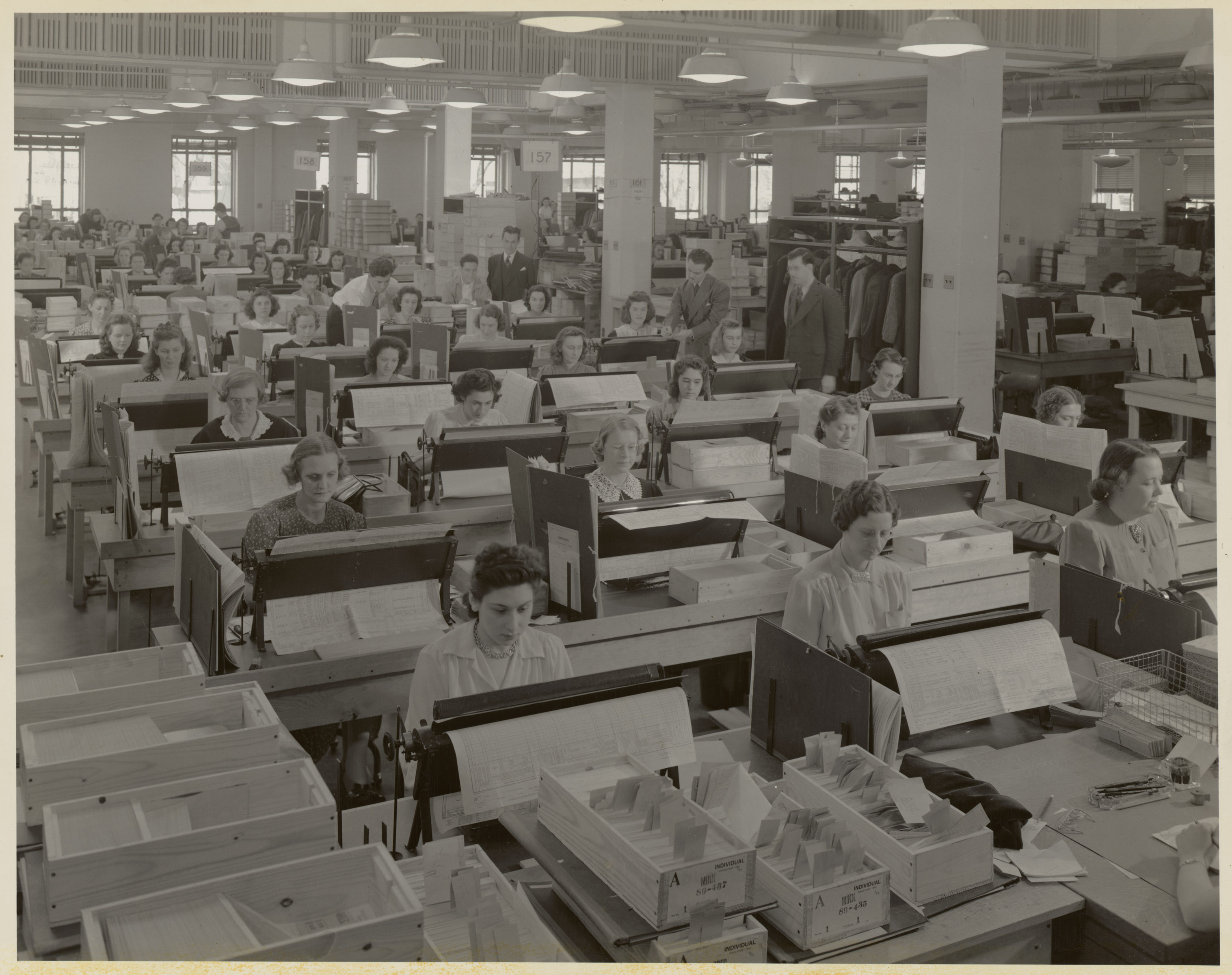 Original caption: Card Punch Operators working on population cards. A total of 2,400 punchers were employed and 1,859 punch machines of all types were used in the 1940 Census. National Archives Identifier: 7741405
