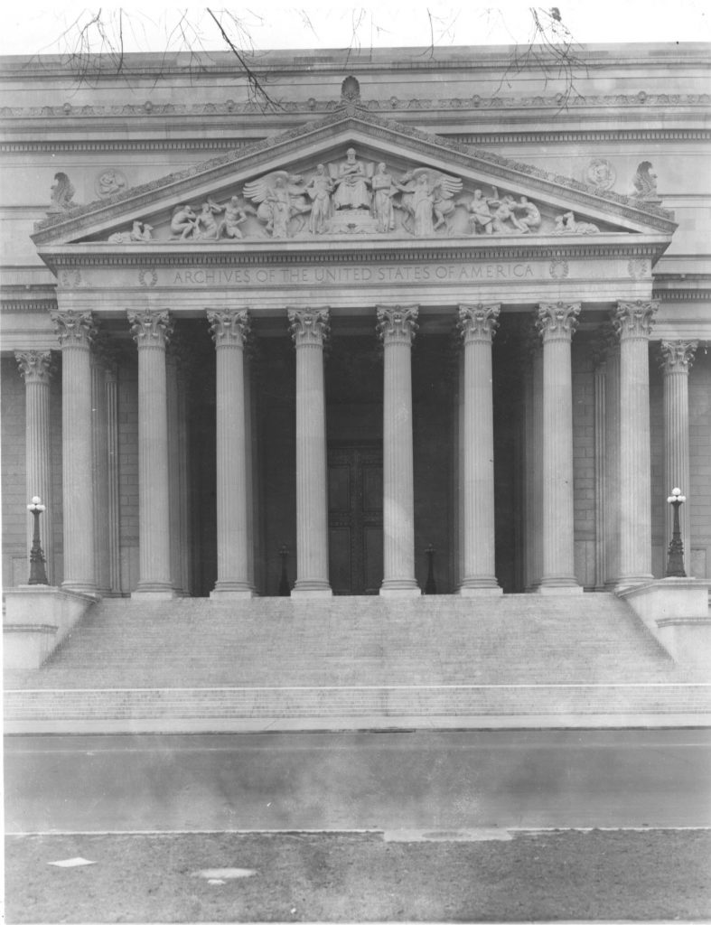 Photograph of the National Archives Building Constitution Avenue Entrance Portico and Pediment, 12/22/1935. (National Archives Identifier: 7820508)