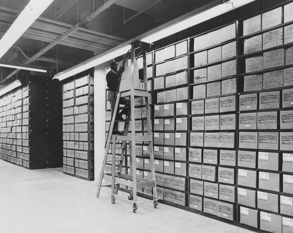 Photograph of Washington National Records Center Stack Area with Employee Servicing Records, ca. 1968. (National Archives Identifier: 4477179) The Washington National Records Center in Suitland, Maryland is one of the largest Federal Record Centers in the National Archives and Records Administration.