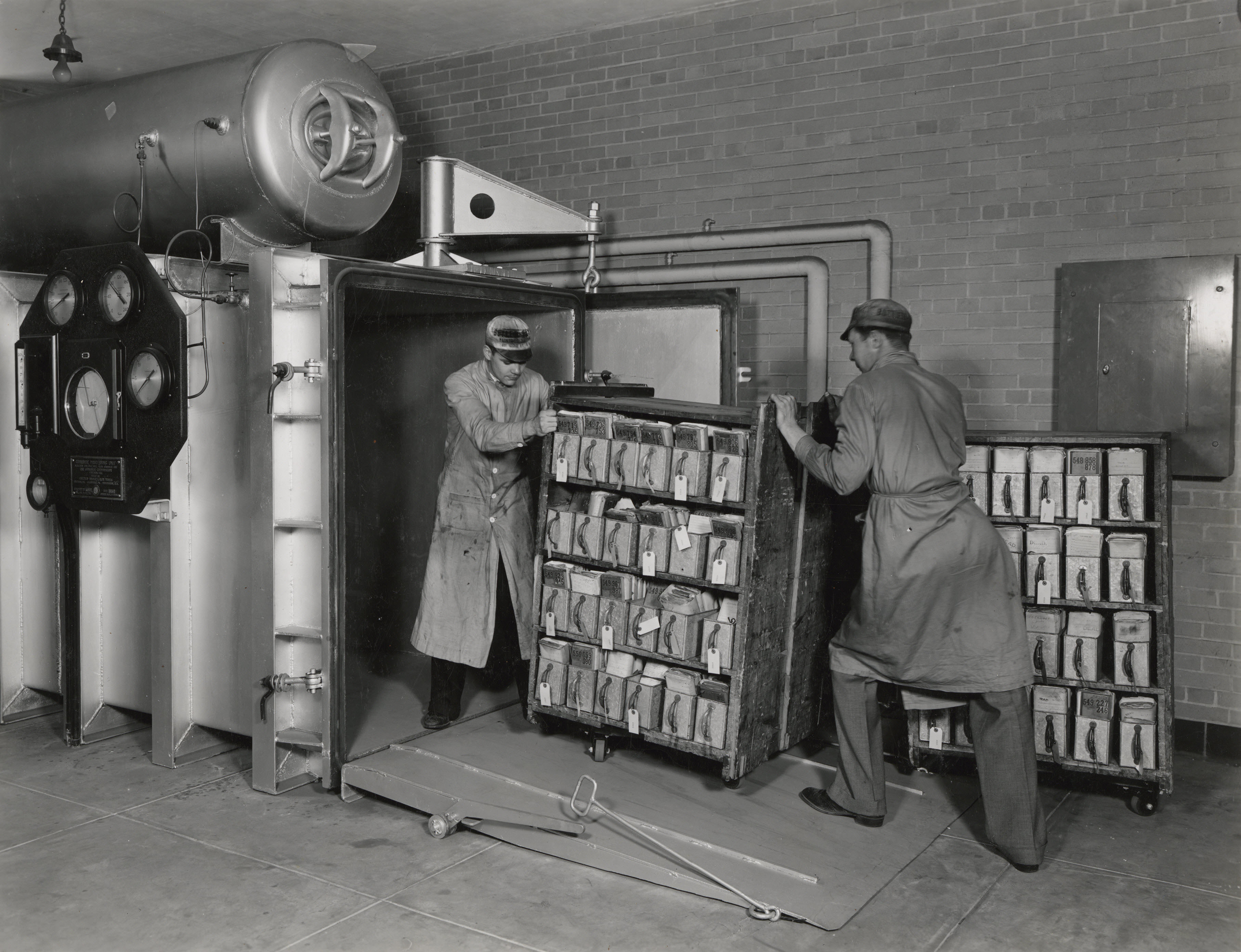 Because government documents were stored in such poor conditions many records, such as these Veterans Administration records, had to be fumigated in a vacuum chamber by National Archives workers, 6/12/1936. (National Archives Identifier 7822037)