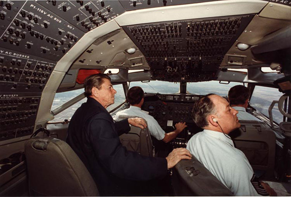 President Ronald Reagan sitting with the crew in the cockpit of Air Force One. 3/16/1982
