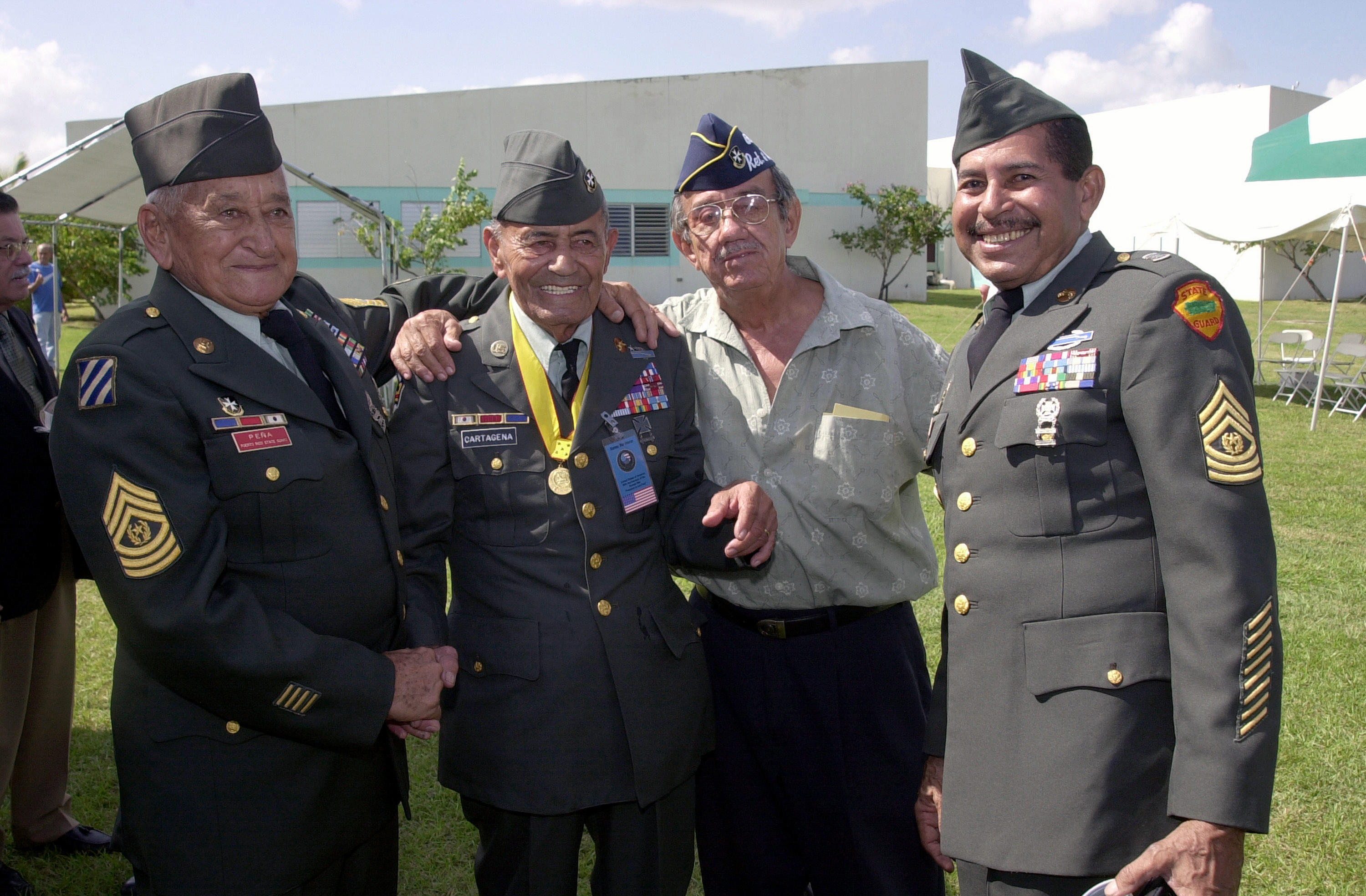 Command Sergeant Major (CSM) Jose Pene, left, Sgt. 1st. Class Modesto Cartagena, second left, and CSM Angel Kuiland, right, veterans of the Korean War during a ceremony at the US Army Reserve center in Puerto Nuevo, Puerto Rico. (National Archives Identifier: 6519407)