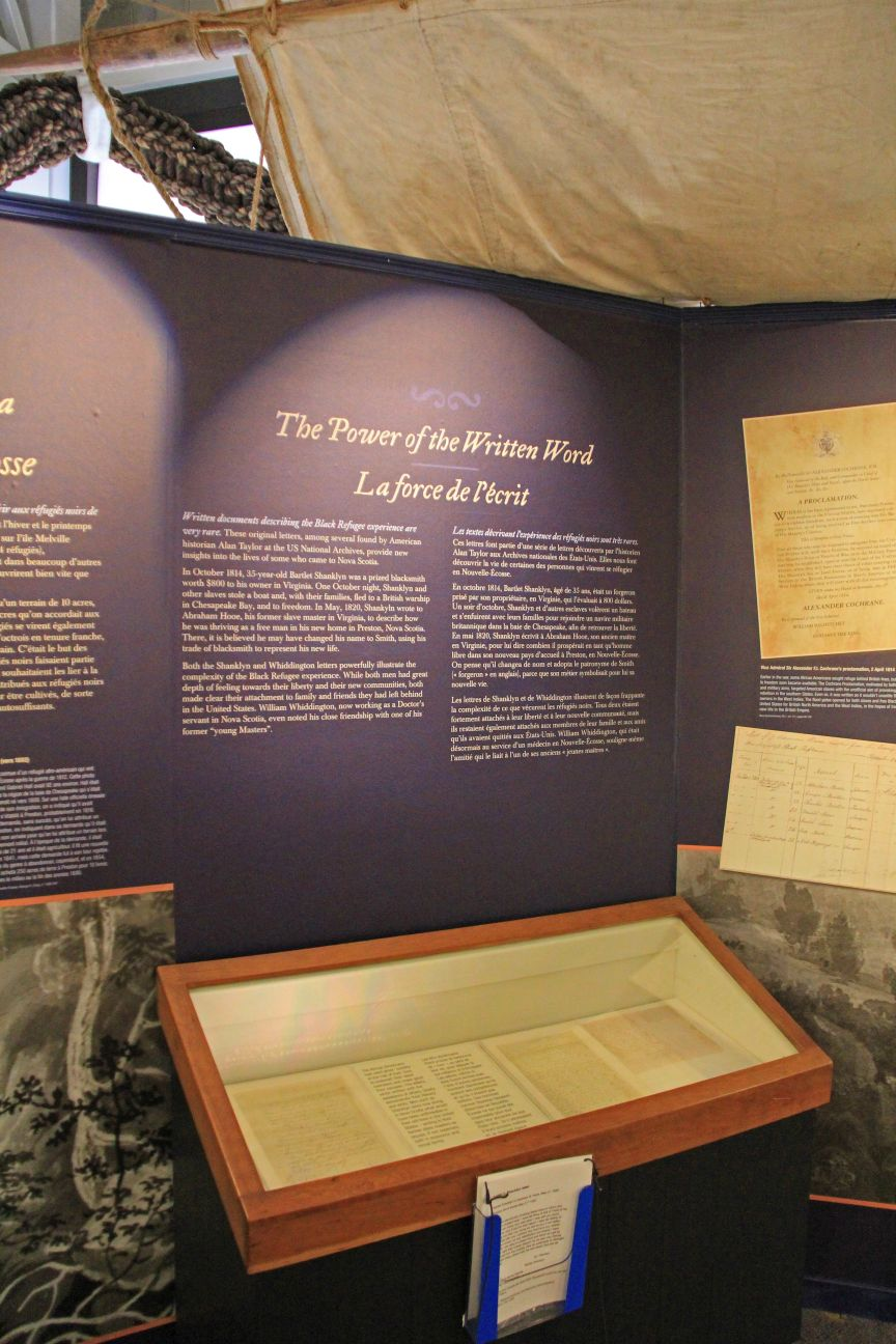 """Display case with Black refugee letters and the panel entitled """"The Power of the Written Word."""" Courtesy of the Maritime Museum of Nova Scotia."""
