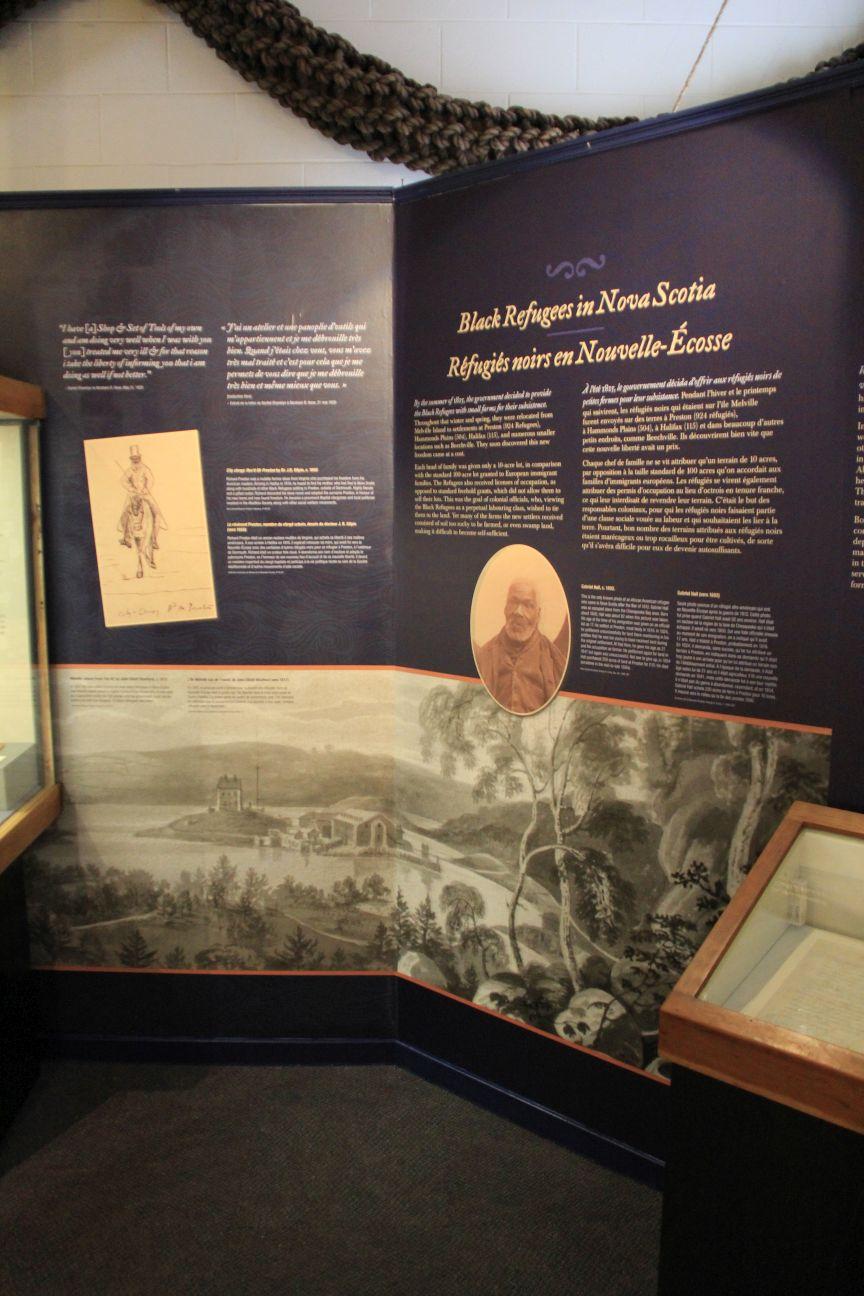 "Left edge of case next to panel reading ""Black Refugees in Nova Scotia."" Courtesy of the Maritime Museum of Nova Scotia."