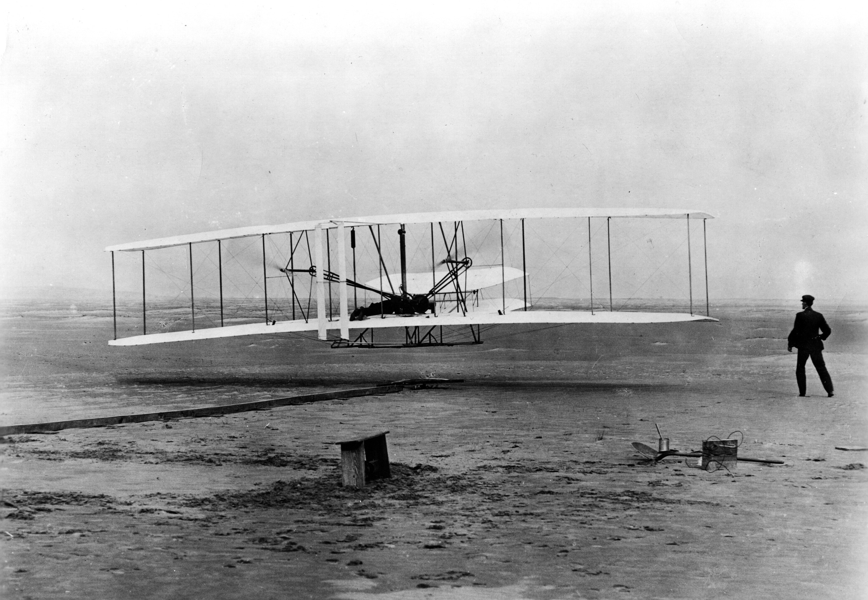 """""""Original Wright Brothers 1903 Aeroplane ('Kitty Hawk') in first flight, December 17, 1903. (National Archives Identifier 7580929)"""