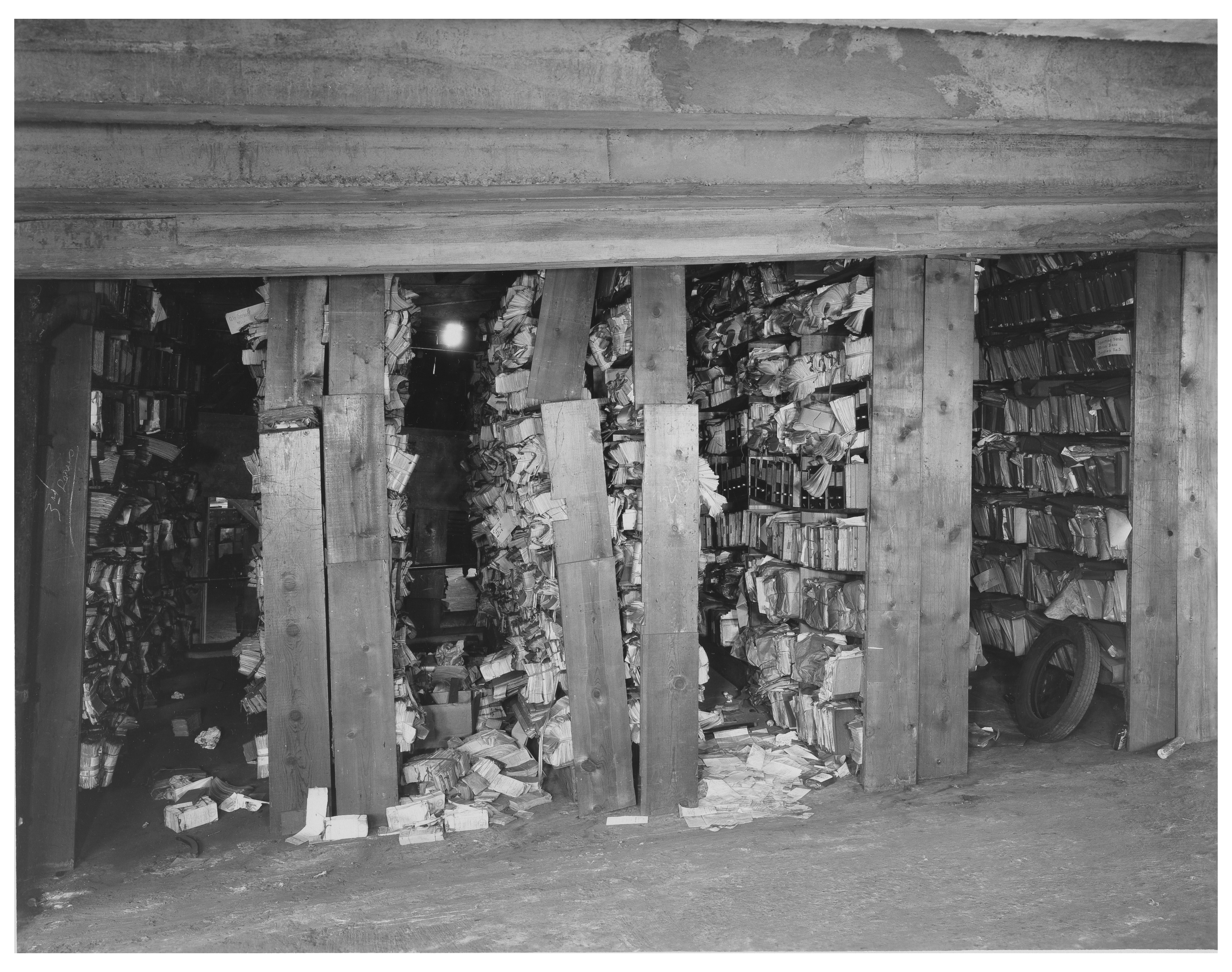 Photograph of poor record storage conditions in the White House Garage, 1935. (Records of the National Archives)