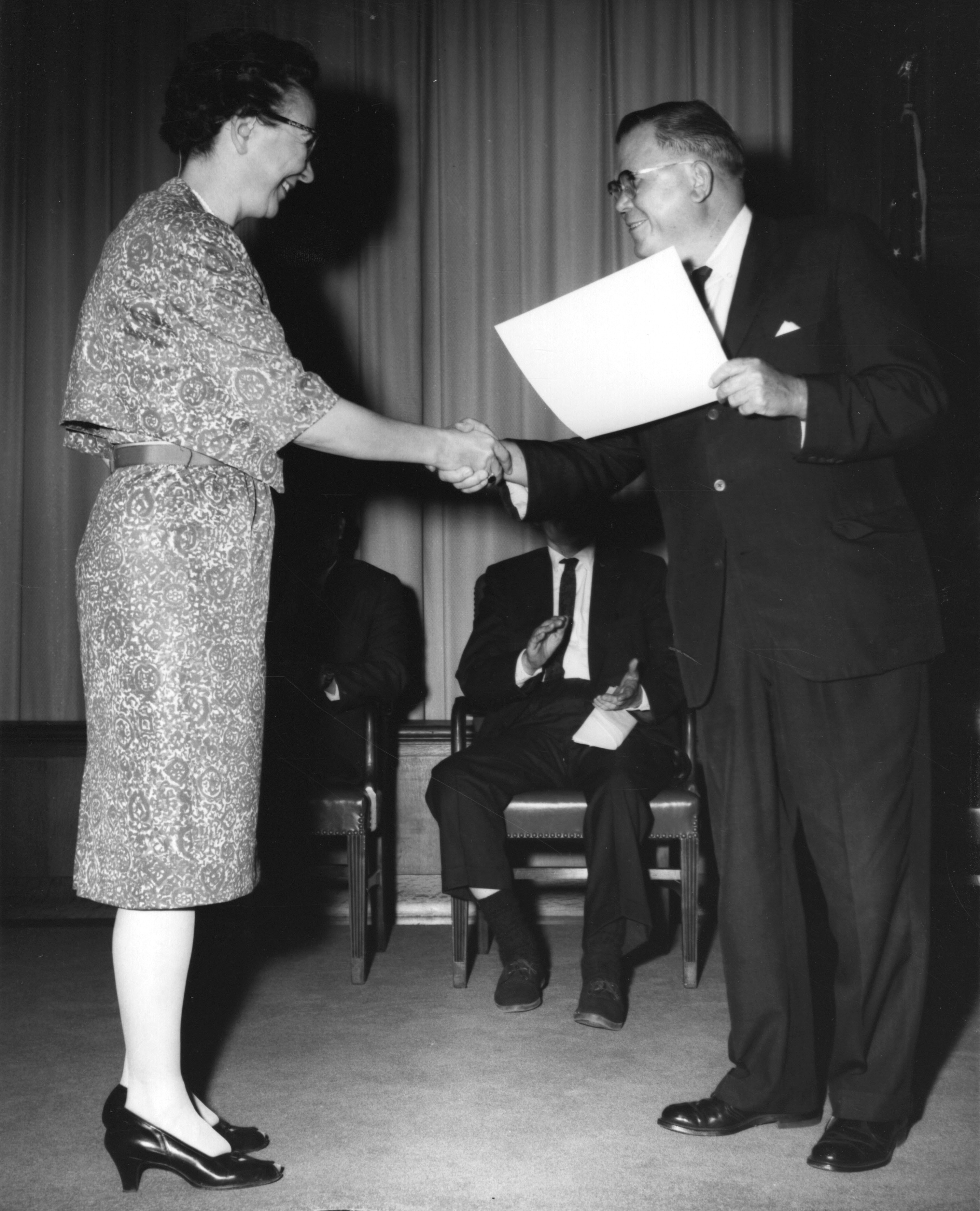 Mabel Deutrich receives Commendable Service Award from Archivist Wayne Grover, Sept. 19, 1963 (National Archives, 64-NA-2255)