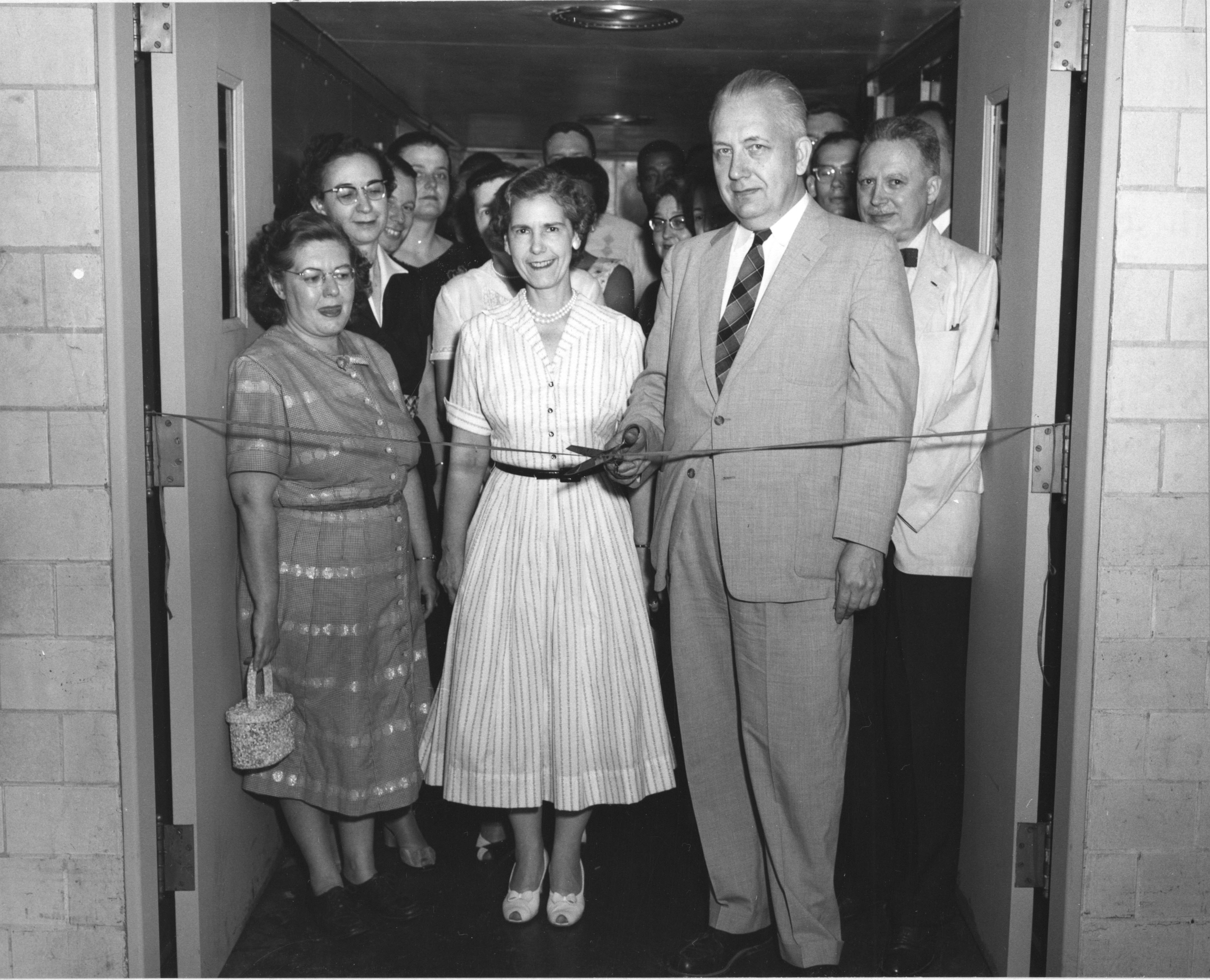 Opening of Civil War Branch Search Room, June 10, 1958. Division Chief Dallas Irvine cuts the ribbon. Branch Chief Victor Gondos at right. (National Archives,  64-NA-1741)