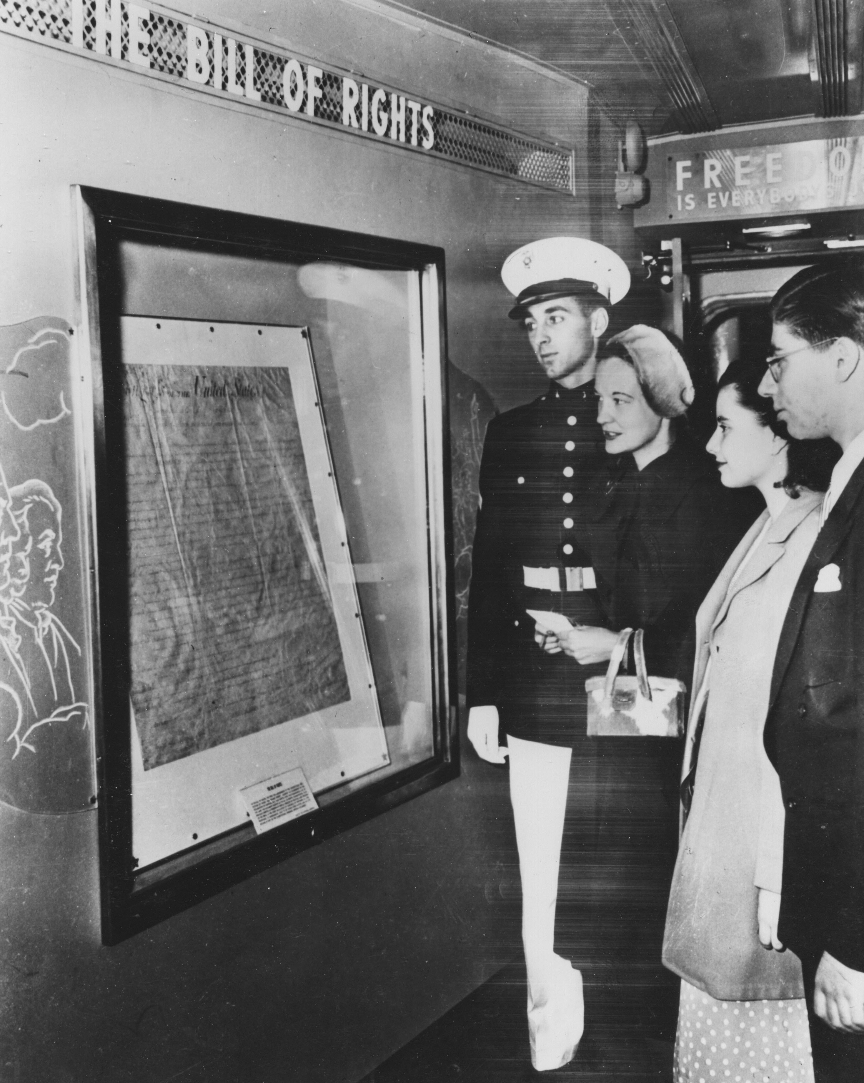 Photograph of visitors looking at the Bill of Rights in the Freedom Train Exhibit, October 20, 1948. (National Archives Identifier 12167308)