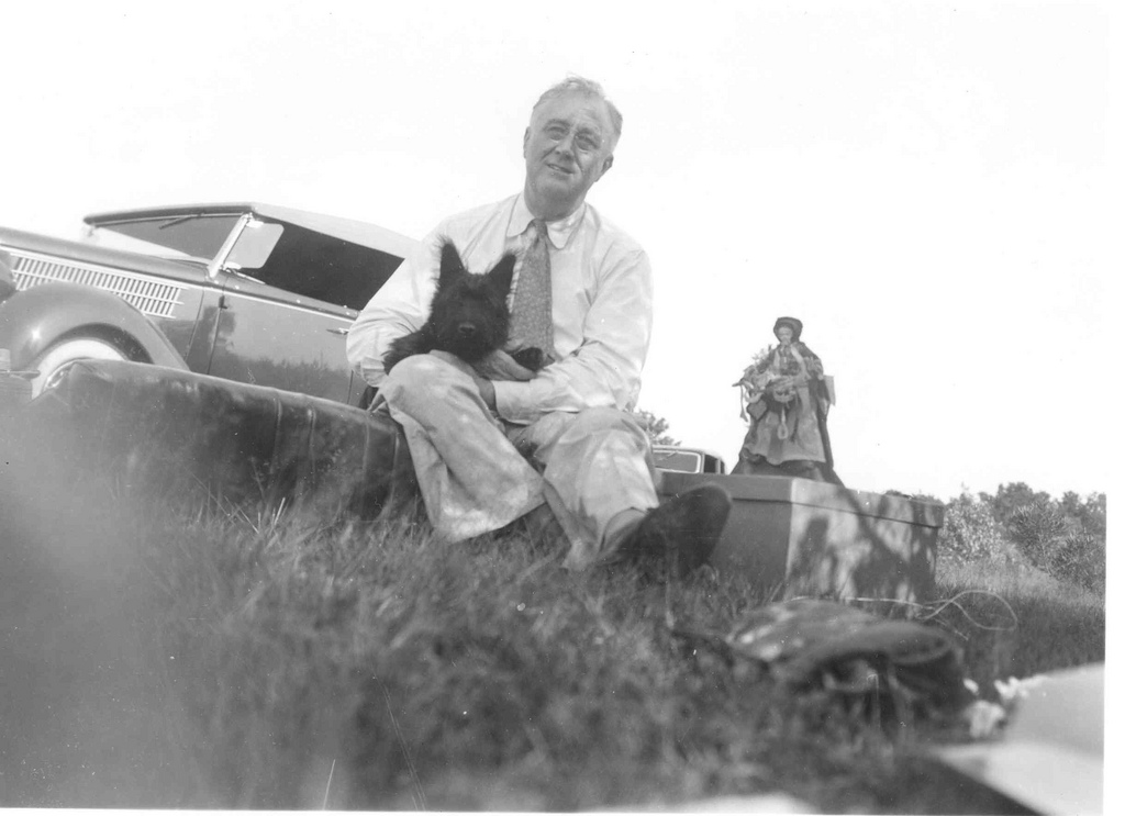 """FDR at a picnic on """"Sunset Hill"""" near Pine Plains, NY, August 8, 1940. Fala is 4 months old. (FDR Library)"""