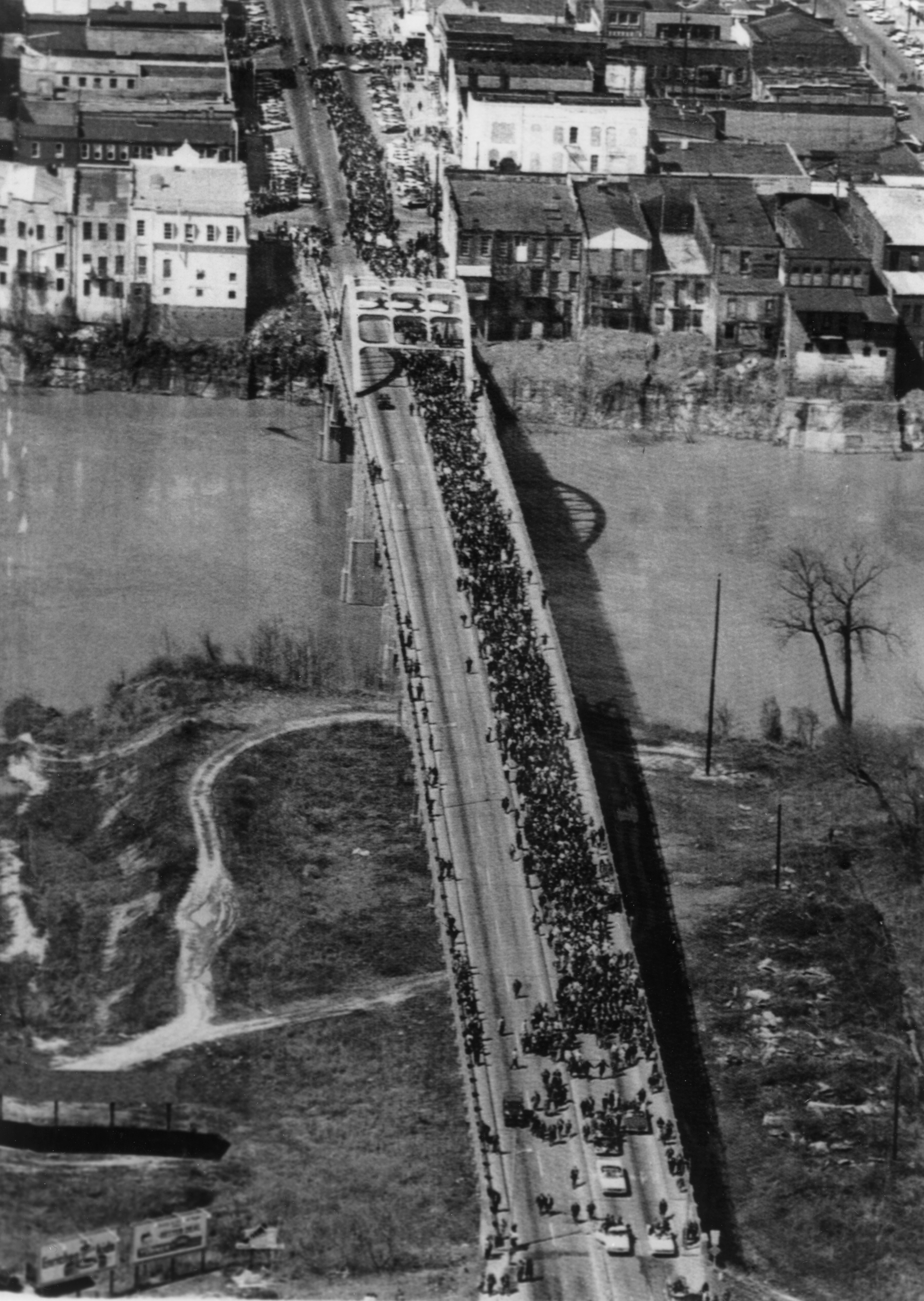 A group of an estimated 3,200 Civil Rights demonstrators crossing the Edmund Pettus Bridge in Selma, March 21, 1965. (Records of the United States Information Agency, National Archives)