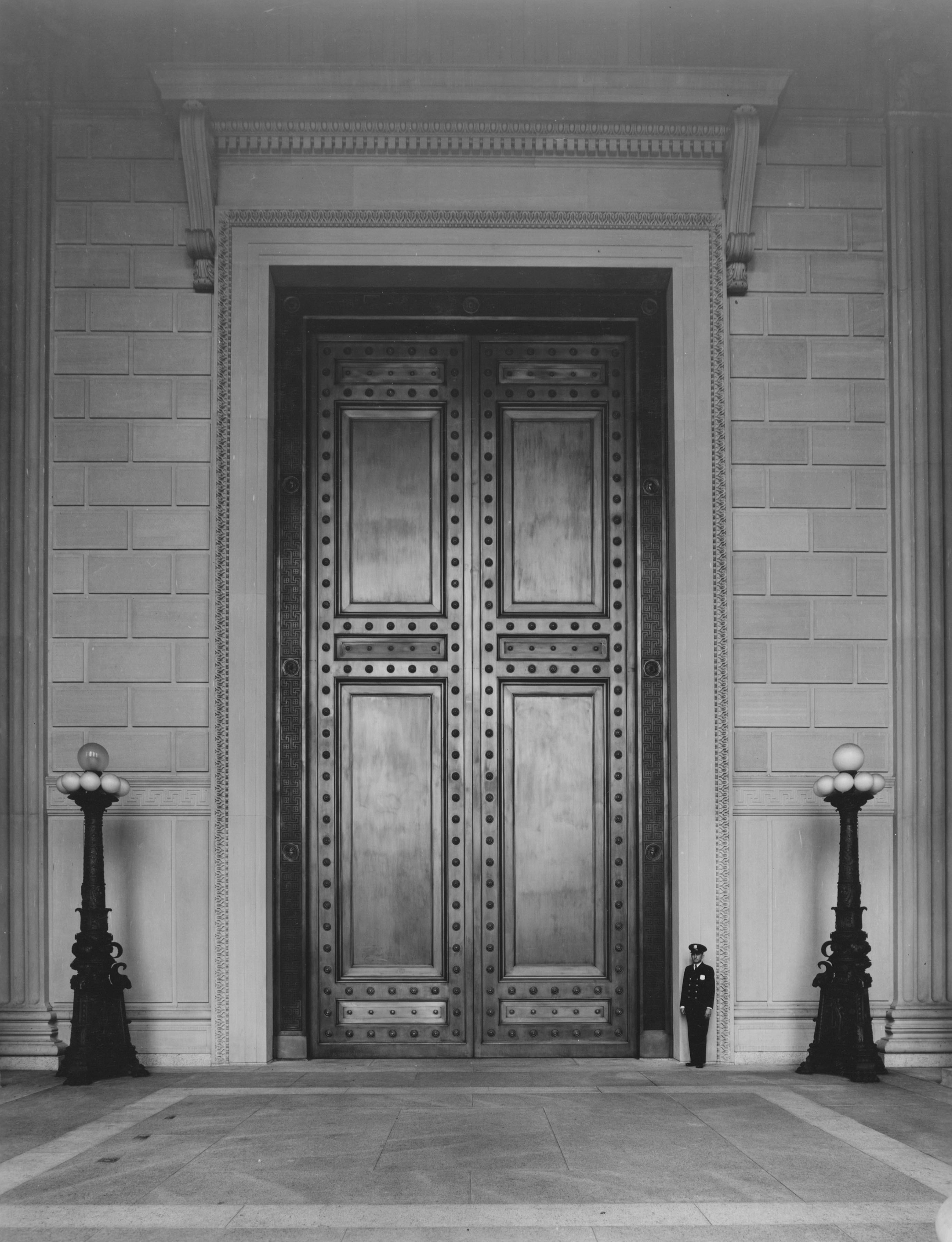 Photograph of the bronze doors marking the National Archives Building's Constitution Avenue Entrance, 06/13/1936.  (National Archives Identifier 7820634)