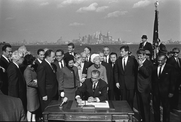 Photograph of President Lyndon B. Johnson Signing the Immigration Act, 10/3/1965. (National Archives Identifier 2803428)