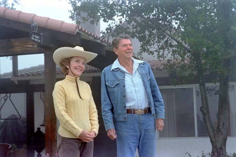 President and Nancy Reagan standing in front of their ranch house at Rancho Del Cielo. 8/13/81.