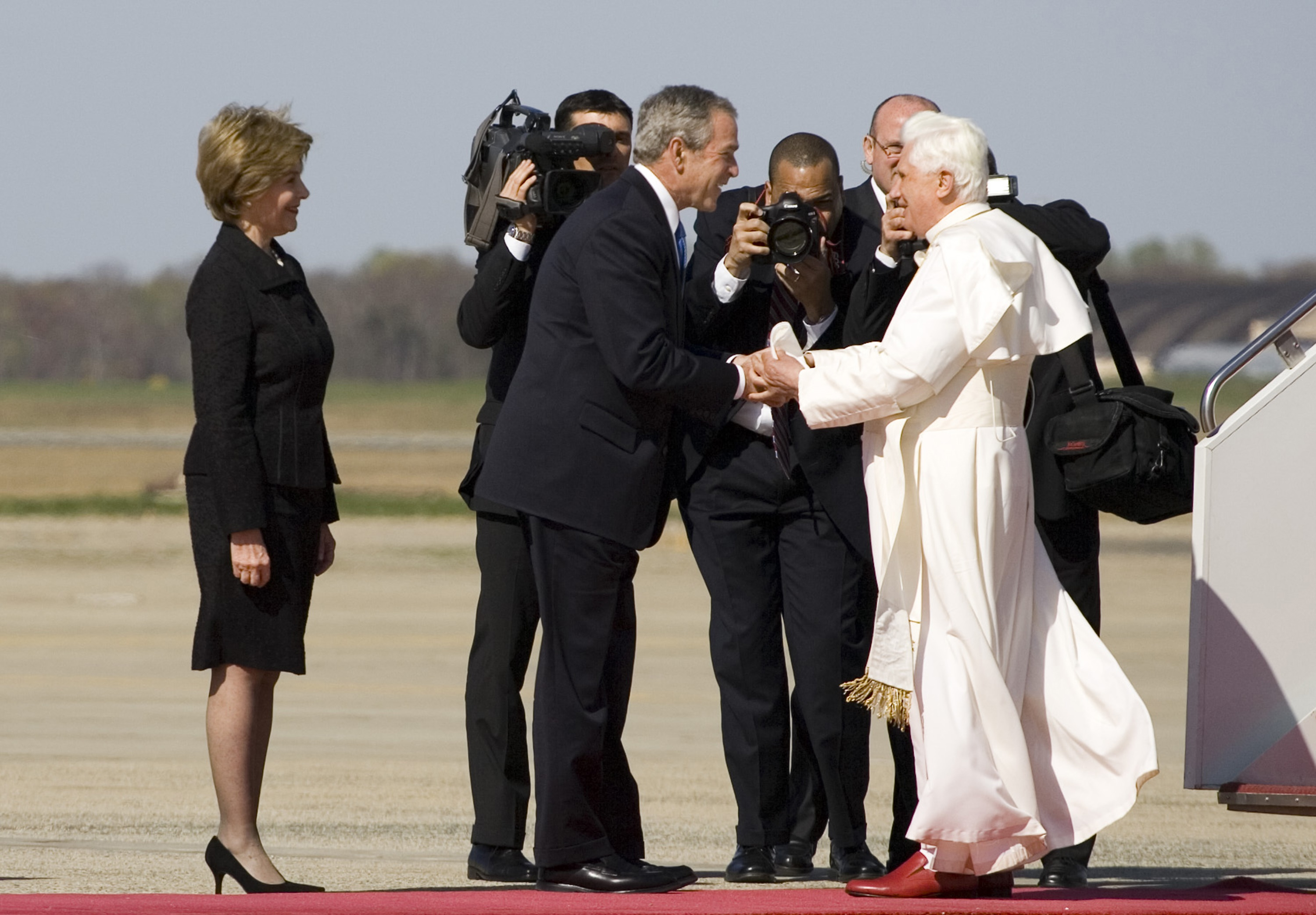 President George W. Bush and Laura Bush Greet Pope Benedict XVI on His Arrival at Andrews Air Force Base, Maryland, April 15, 2008. (National Archives Identifier 7582808)